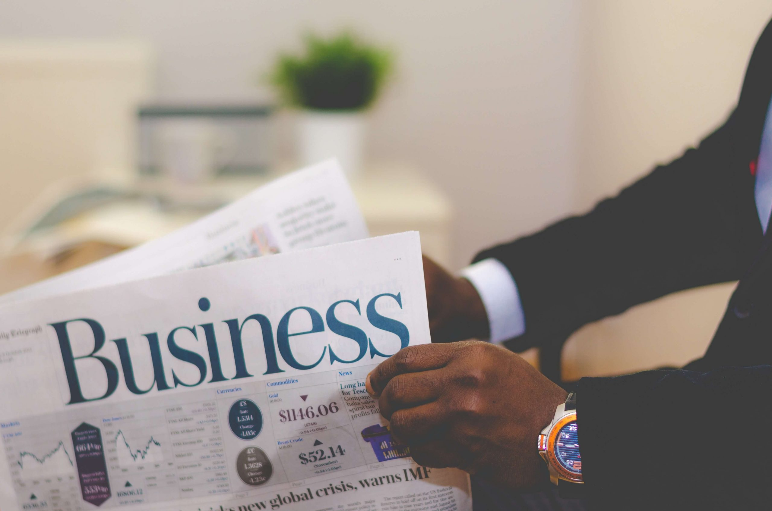 Man reading the business section of a newspaper